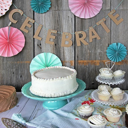 Celebration table with cakes and cupcakes